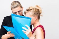Businesswomen looking at documents Stock Image