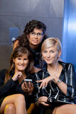 Businesswomen looking at smart phone Royalty Free Stock Photos