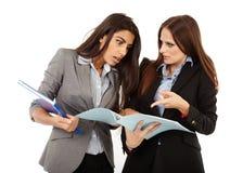 Businesswomen looking to documents Stock Photo