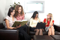 Businesswomen in lounge Stock Images