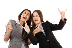 Businesswomen making the rock and roll hand gesture Stock Images