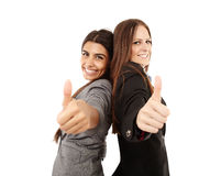 Businesswomen making thumbs up sign Royalty Free Stock Photos
