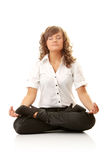 Businesswomen meditating in lotus position Royalty Free Stock Images