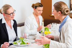 Businesswomen meeting at business dinner. Or lunch in Restaurant stock photography