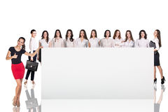 Businesswomen near a big placard Royalty Free Stock Photography