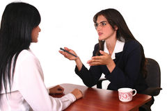 Businesswomen negotiation. Couple of busineswoman doing business one explaning  to the other Stock Images