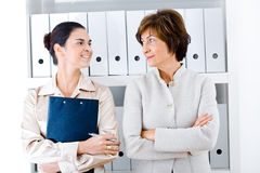 Businesswomen in office Stock Image