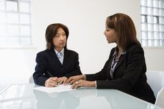 Businesswomen in office stock photography
