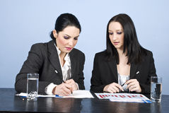 Businesswomen in office write at meeting Royalty Free Stock Images