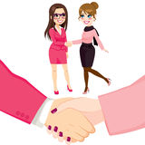 Businesswomen People Shaking Hands. Young businesswomen people shaking hands on a successful agreement Royalty Free Stock Image