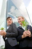 Businesswomen with Plants Royalty Free Stock Image