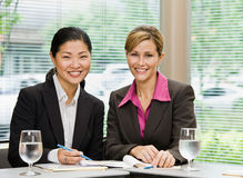 Businesswomen posing in conference room Stock Images