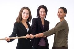 Businesswomen pulling together Royalty Free Stock Photos