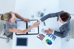 Businesswomen reaching an agreement Stock Photo