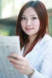 businesswomen reading newspaer Stock Photos
