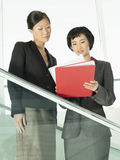 Businesswomen Reviewing Documents On Stairs Royalty Free Stock Image