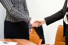 Businesswomen shake hands each other royalty free stock photo
