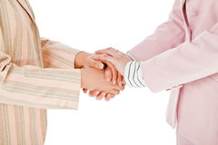 Businesswomen shaking hands Stock Photo