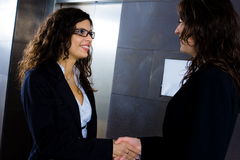 Businesswomen shaking hands Stock Photos