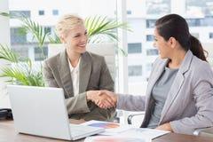 Businesswomen shaking hands Royalty Free Stock Image