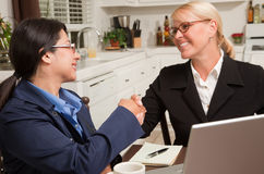 Businesswomen Shaking Hands Working on the Laptop Stock Images