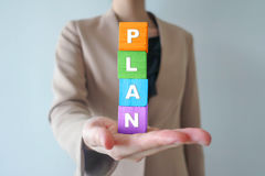 Businesswomen show Plan words on wooden cube Stock Photo