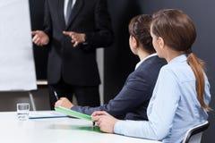 Businesswomen sitting at the desk Stock Photo