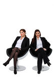 Businesswomen sitting together Stock Images