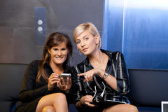 Businesswomen with smart phone Stock Photo