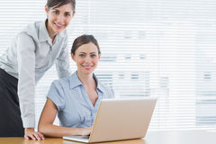 Businesswomen smiling at the camera Stock Photography