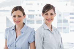 Businesswomen smiling at camera Stock Images