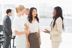 Businesswomen speaking together in conference room Royalty Free Stock Photography