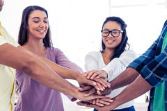 Businesswomen stacking hands with team Royalty Free Stock Photography