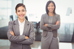 Businesswomen standing with arms crossed Royalty Free Stock Photography