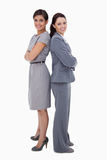 Businesswomen standing back on back Royalty Free Stock Image