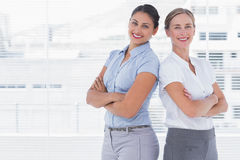 Businesswomen standing back to back Royalty Free Stock Photos