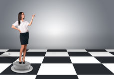Businesswomen standing and pushing an imaginary Royalty Free Stock Photos