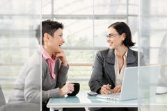 Businesswomen talking Stock Photo