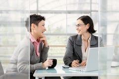 Businesswomen talking stock photo