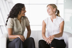 Businesswomen talking in lobby Royalty Free Stock Photo