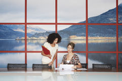 Businesswomen Talking In Modern Conference Room Stock Photography