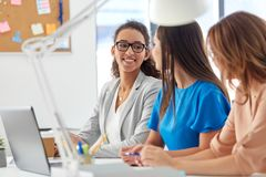 Businesswomen talking at office Stock Images