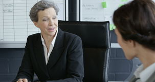 Businesswomen talking. In the office stock video footage