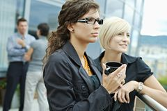 Businesswomen talking outdoor Stock Photo