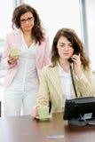 Businesswomen talking on phone Royalty Free Stock Photos