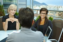 Businesswomen talking on terrace Stock Image