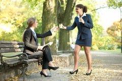 Businesswomen together on break Stock Photo