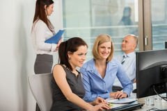 Businesswomen Using Computer In Office Royalty Free Stock Photo