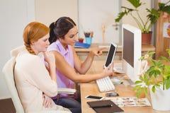Businesswomen using digital tablet Stock Photography