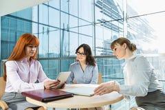 Businesswomen using digital tablet in office Royalty Free Stock Photo